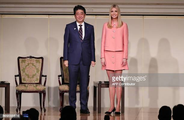 Ivanka Trump the daughter and assistant to US President Donald Trump right and Japanese Prime Minister Shinzo Abe left stand together at the World...