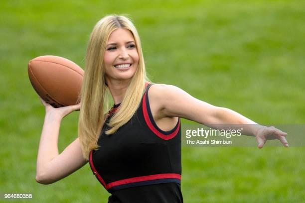 Ivanka Trump throws a football during a White House Sports and Fitness Day at the South Lawn of the White House on May 30 2018 in Washington DC...