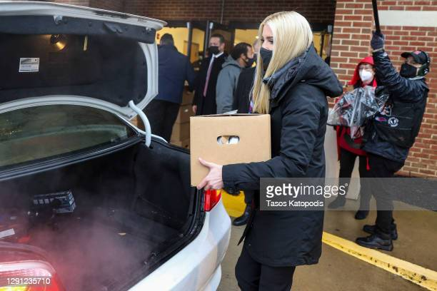 Ivanka Trump, U.S. President Donald Trump's daughter, carries a Farmers to Families Food Box at Christ Church on December 14, 2020 in Woodbridge,...