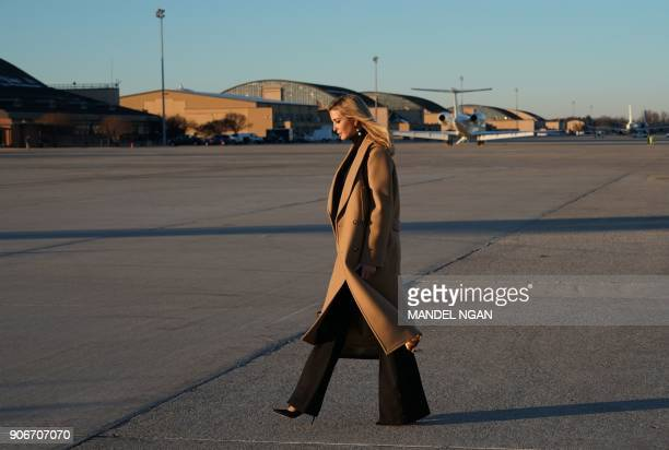 Ivanka Trump walks across the tarmac upon return to Andrews Air Force in Maryland on January 18 2018 She was traveling with US President Donald Trump...