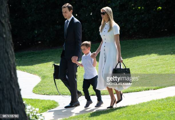 Ivanka Trump walks with her husband Jared Kushner and their son Theodore to board Marine One at the White House in Washington DC on June 29 2018 as...
