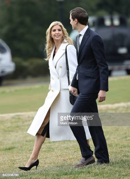 Ivanka Trump walks with her husband White House Senior Advisor Jared Kushner toward Marine One while departing with her father President Donald Trump...