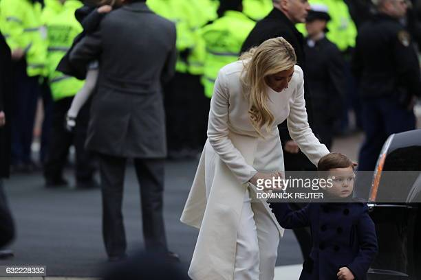 Ivanka Trump walks with her son Joseph during the inaugural parade in Washington DC on January 20 2017  US President Donald Trump on Friday stepped...