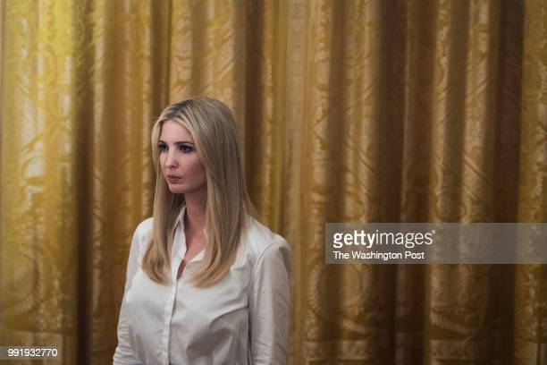 Ivanka Trump watches as President Donald J Trump speaks before presenting Pauline Connor widow of 1st Lt Garlin Conner with the posthumous Medal of...
