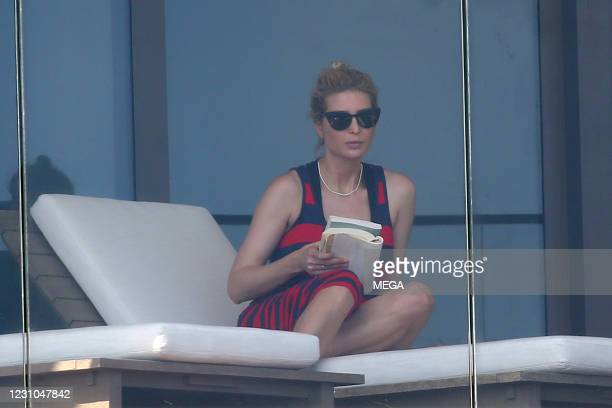 Ivanka Trump wears a red and black dress as she relaxes on her balcony on February 8, 2021 in Miami, Florida.