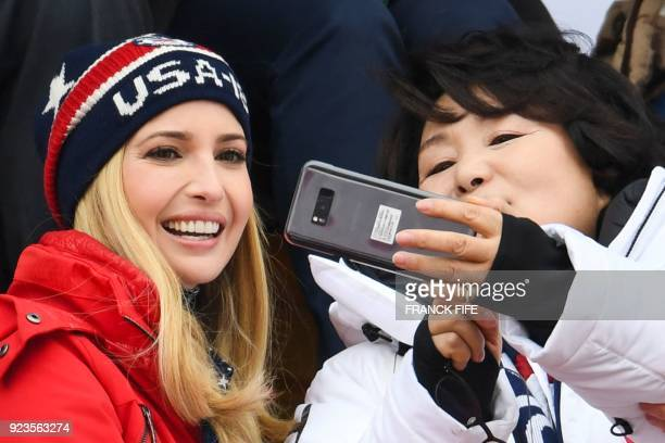 Ivanka Trump wife of Korean President Moon Jae-in, Kim Jung-sook take a selfie while watching the final of the men's snowboard big air event at the...