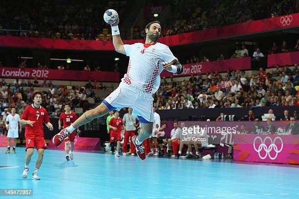 Ivano Balic of Croatia jumps to score during the Men's Handball preliminaries group B match between Croatia and Korea on Day 2 of the London 2012...