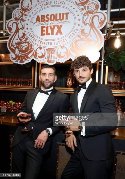 Ivano Marino and Giovanni Masiero attend the amfAR Gala at Palazzo Mezzanotte on September 21 2019 in Milan Italy