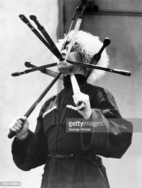 5/24/1926 B Ivanoff world champion sword dancer does not confine his efforts to dancing with edged weapons but swallows them as well He is one of the...