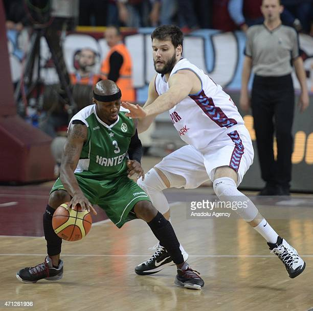 Ivanov Kaloyan of Trabzonspor Medical Park vies for ball with Joesph Gomis of Nanterre during the FIBA EuroChallenge Final Four basketball match...