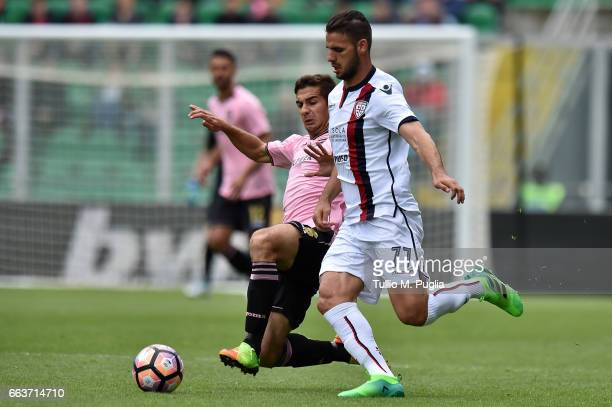 Ivaylo Chochev of Palermo and Panagiotis Tachtsidis of Cagliari compete for the ball during the Serie A match between US Citta di Palermo and...