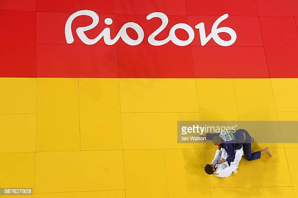 Ivaylo Ivanov of Bulgaria and Frank de Wit of the Netherlands compete during the Men's 81kg bout on Day 4 of the Rio 2016 Olympic Games at the...