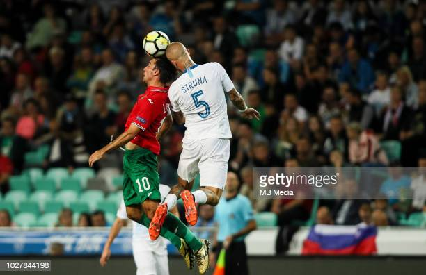 Ivelin Popov of Bulgaria and Aljaz Struna of Slovenia jump for a ball during football match between National Teams of Slovenia and Bulgaria in Final...