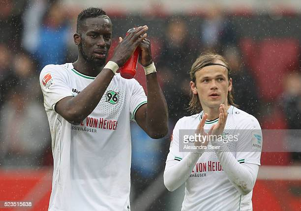 Iver Fossum and Salif Sane of Hannover 96 react to their fans after the Bundesliga match between FC Ingolstadt and Hannover 96 at Audi Sportpark on...