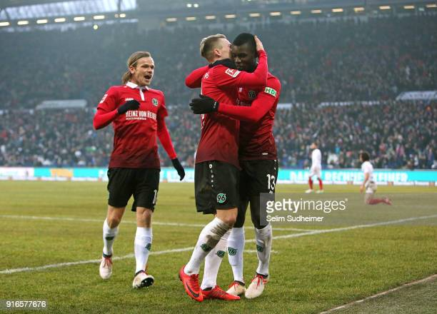 Iver Fossum Felix Klaus and Ihlas Bebou of Hannover 96 celebrate their teams second goal scoring during the Bundesliga match between Hannover 96 and...