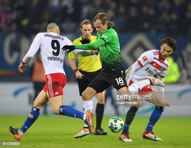 Iver Fossum of Hannover is challenged by Kyriakos Papadopoulos and Filip Kostic of Hamburg during the Bundesliga match between Hamburger SV and...