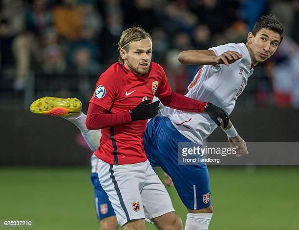 Iver Fossum of Norway Marko Grujic of Serbia during U21UEFA European Championship PlayOff Norway v Serbia at Marienlyst Stadion on November 15 2016...