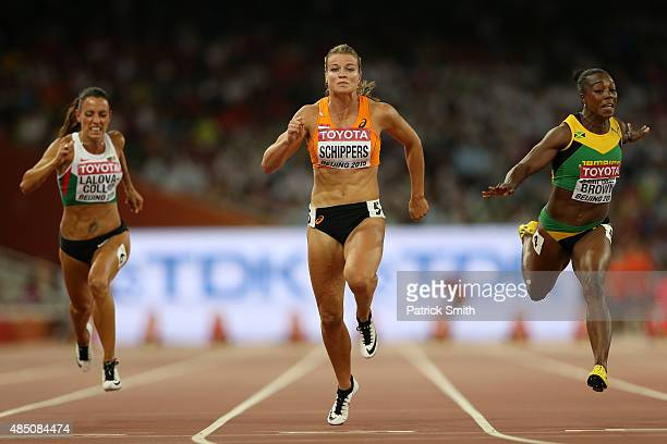Ivet Lalova-Collio of Bulgaria, Dafne Schippers of the Netherlands and Veronica Campbell-Brown of Jamaica cross the finish line in the Women's 100...