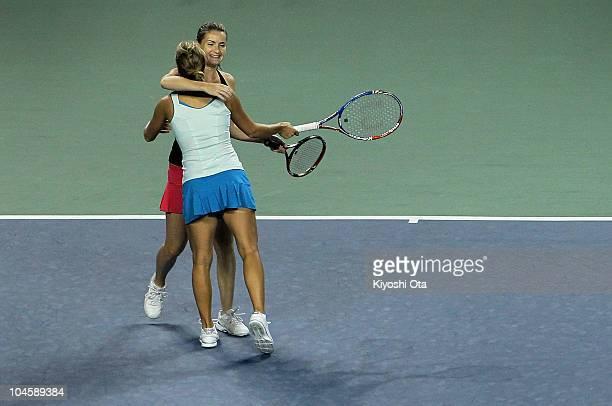 Iveta Benesova and Barbora Zahlavova Strycova of the Czech Republic celebrate after winning the Women's Doubles semi final match against Lisa Raymond...