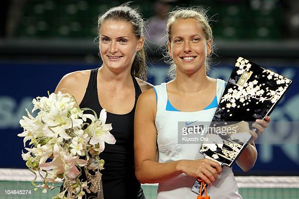 Iveta Benesova and Barbora Zahlavova Strycova of the Czech Republic pose with a trophy during the award ceremony after winning the Women's Doubles...