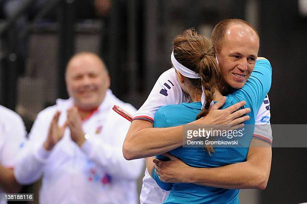 Iveta Benesova of Czech Republic celebrates with teamcaptain Petr Pala after winning her single match against Sabine Lisicki of Germany during day...