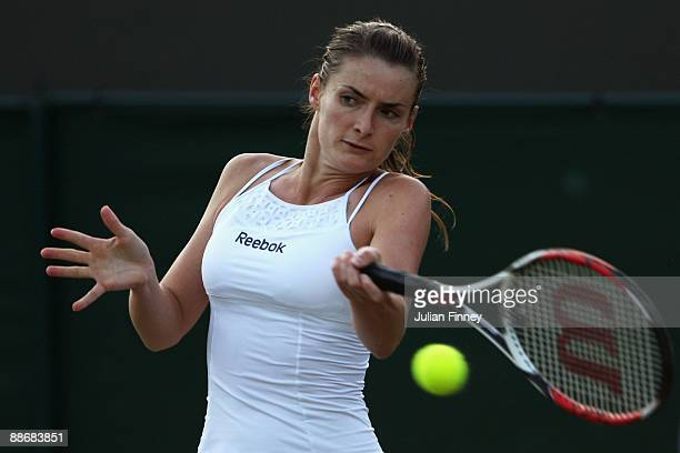 Iveta Benesova of Czech Republic plays a forehand during the women's singles second round match against Jelena Jankovic of Serbia on Day Four of the...