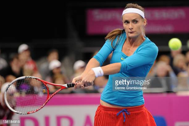 Iveta Benesova of Czech Republic returns the ball at her single match against Sabine Lisicki of Germany during day one of the Federation Cup 2012...