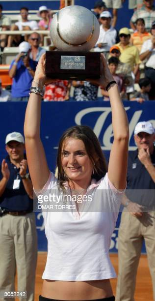 Iveta Benesova of the Czech Republic lifts the Championship's trophy of the WTA Mexican Open after beating Italian Flavia Pennetta by 7-6 , 6-4 , in...