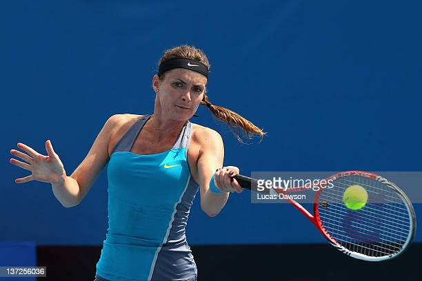 Iveta Benesova of the Czech Republic plays a forehand in her second round match against Shuai Peng of China during day three of the 2012 Australian...