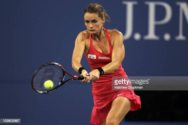 Iveta Benesova of the Czech Republic returns a shot to Maria Sharapova of Russia during day four of the 2010 U.S. Open at the USTA Billie Jean King...