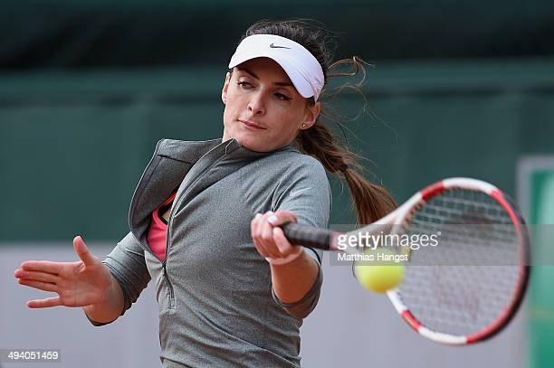 Iveta Melzer of Czech Republic returns a shot during her women's singles match against Coco Vandeweghe of the United States on day three of the...