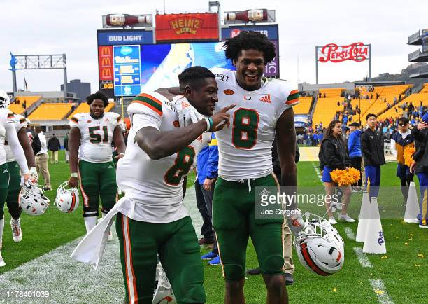 Ivey celebrates with Dee Wiggins of the Miami Hurricanes after a 16-12 win over the Pittsburgh Panthers at Heinz Field on October 26, 2019 in...