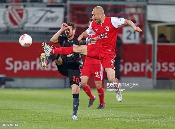 Ivica Bajanovic of Cottbus battles for the ball with Albert Bunjaku of Kaiserslautern during the Second Bundesliga match between FC Energie Cottbus...