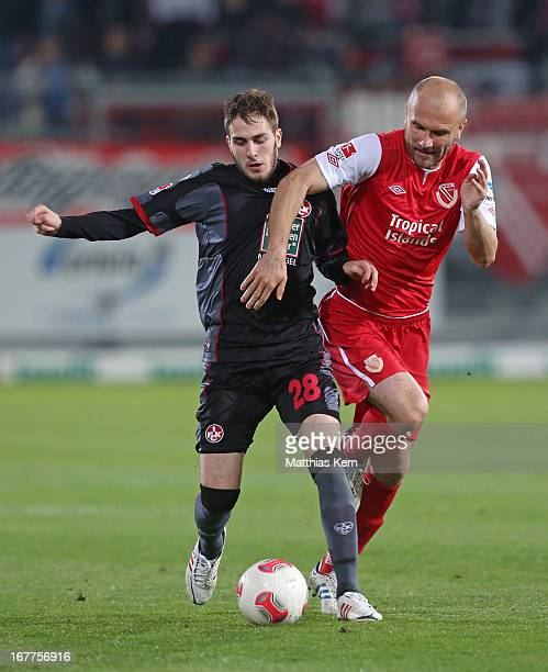Ivica Banovic of Cottbus battles for the ball with Kostas Fortounis of Kaiserslautern during the Second Bundesliga match between FC Energie Cottbus...