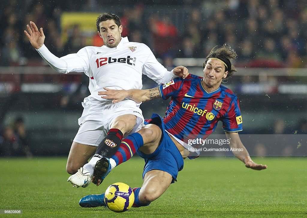 Ivica Dragutinovic of Sevilla (L) duels for the ball with Zlatan Ibrahimovic of FC Barcelona during the La Liga match between Barcelona and Sevilla at the Camp Nou stadium on January 16, 2010 in Barcelona, Spain. Barcelona won 4-0.