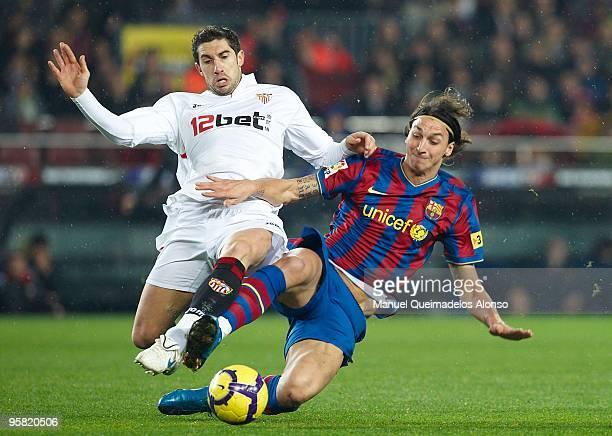 Ivica Dragutinovic of Sevilla duels for the ball with Zlatan Ibrahimovic of FC Barcelona during the La Liga match between Barcelona and Sevilla at...