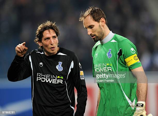 Ivica Grlic and Tom Starke of Duisburg look dejected at the end of the Second Bundesliga match between FC Hansa Rostock and MSV Duisburg at the DKB...