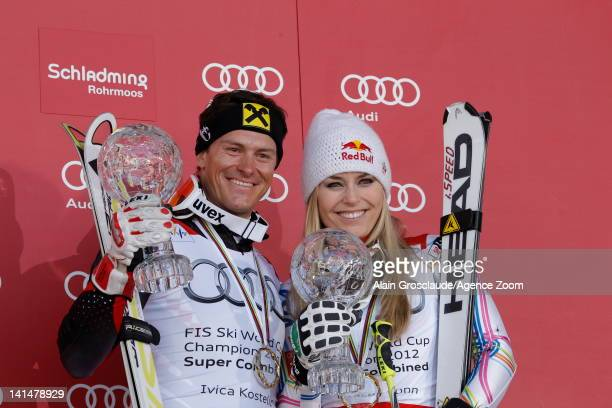 Ivica Kostelic of Croatia and Lindsey Vonn of the USA win the Overall Combined globes on March 17 2012 in Schladming Austria
