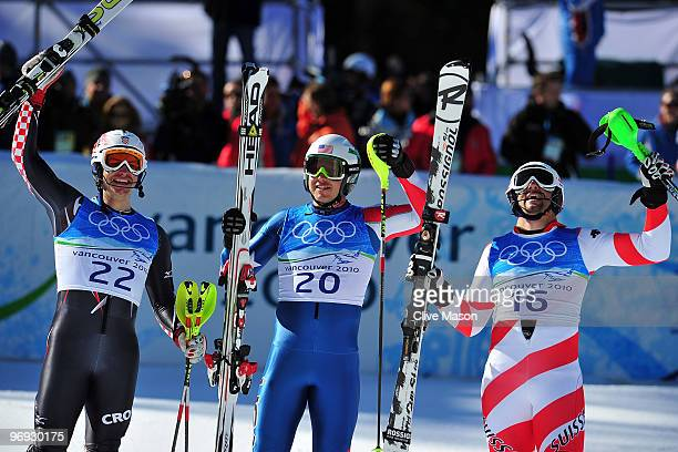 Ivica Kostelic of Croatia Bode Miller of the United States and Silvan Zurbriggen of Switzerland celebrate at the finish during the Alpine Skiing...
