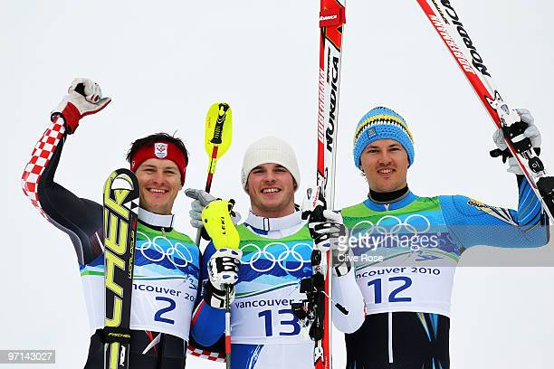 Ivica Kostelic of Croatia celebrates winning silver Giuliano Razzoli of Italy gold and Andre Myhrer of Sweden bronze during the flower ceremony for...