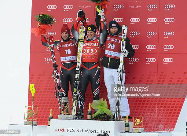 Ivica Kostelic of Croatia takes 1st place Natko ZrncicDim of Croatia takes 2nd place Aksel Lund Svindal of Norway takes 3rd place during the Audi FIS...