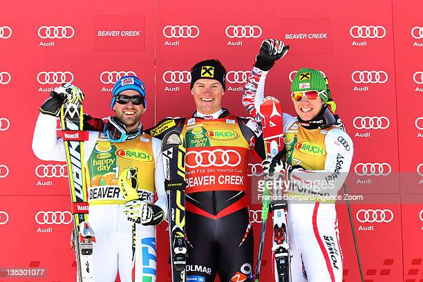 Ivica Kostelic of Croatia takes first place Cristian Deville of Italy takes second place and Marcel Hirscher of Austria takes third place during the...