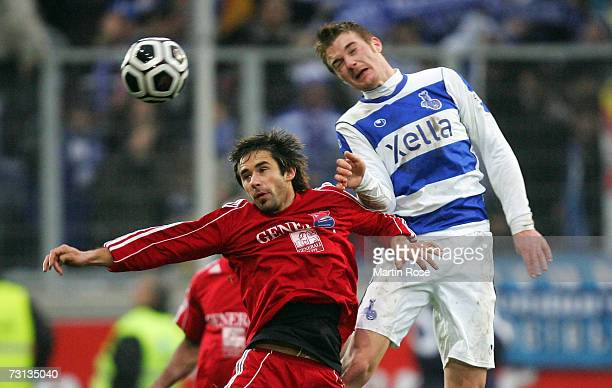Ivica Majstorovic of Unterhaching and Klemen Lavric of Duisburg head for the ball during the Second Bundesliga match between MSV Duisburg and Spvgg...