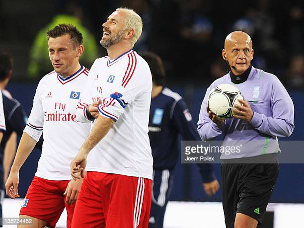 Ivica Olic and Sergej Barbarez of the team HSV Allstars and referee Pierluigi Collinaare seen during the 'Match Against Poverty' match at Imtech...