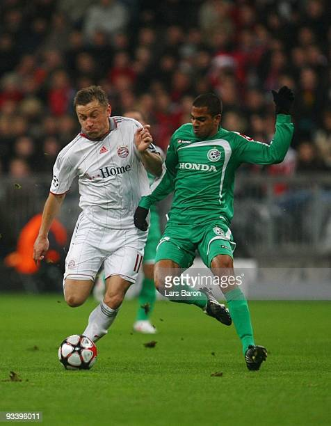 Ivica Olic of Bayern and Eyal Meshumar of Haifa battle for the ball during the UEFA Champions League Group A match between FC Bayern Muenchen and...