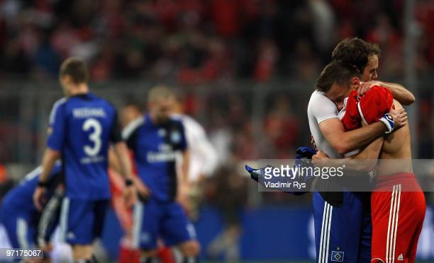 Ivica Olic of Bayern hugs Joris Mathijsen of Hamburg after the Bundesliga match between FC Bayern Muenchen and Hamburger SV at Allianz Arena on...