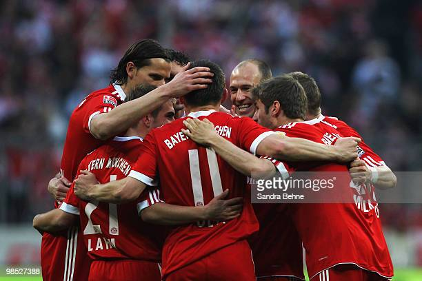 Ivica Olic of Bayern is celebrated by team mates after scoring the fourth goal during the Bundesliga match between FC Bayern Muenchen and Hannover 96...