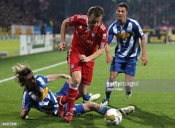 Ivica Olic of Bayern is challenged by Christian Fuchs and Roman Prokoph of Bochum during the Bundesliga match between VfL Bochum and FC Bayern...