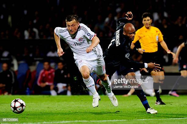 Ivica Olic of Bayern Muenchen goes past Jean Alain Boumsong of Olympique Lyonnais during the UEFA Champions League semi final second leg match...