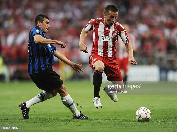 Ivica Olic of Bayern Muenchen is challenged by Lucio of Inter Milan during the UEFA Champions League Final match between FC Bayern Muenchen and Inter...